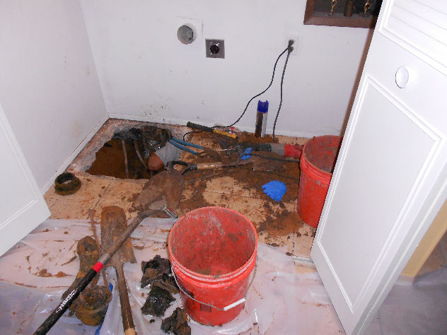 Photo of hole in the slab foundation and floor.