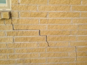 Photo showing diagonal cracks in brick wall