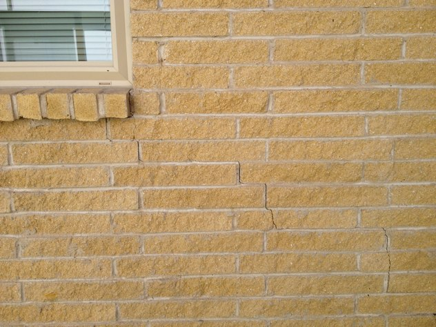 Photo showing the closing of a crack in brick facade of house following foundation repair.